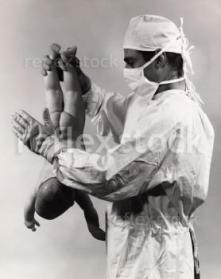 Male-doctor-spanking-a-newborn-baby-12383229-0